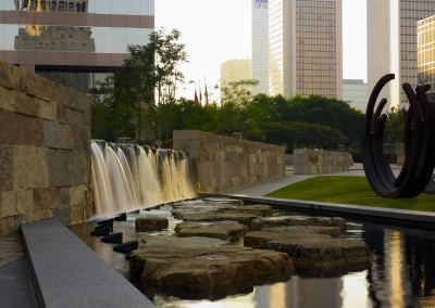 Paved, winding paths lead visitors past 24 sculptures resting on wide lawns, six rain gardens, a children's spray plaza and a 180-foot-long pool with a six-foot waterfall.