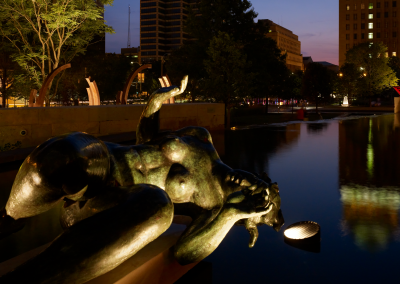 Statue set by reflecting pool at Citygarden