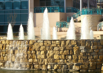 Various sized cascade nozzles in the center of the fountain provide a focal point,