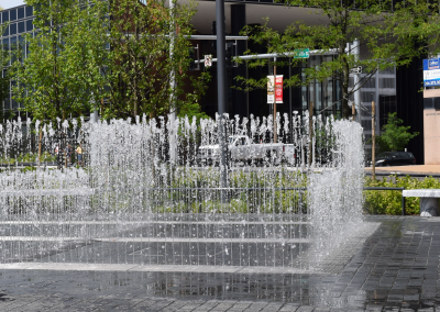 The splash pad has hundreds of nozzles that shoot water up at varying heights.