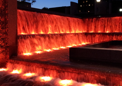The waterfalls tumble into pools which are illuminated at night with thousands of color combinations.