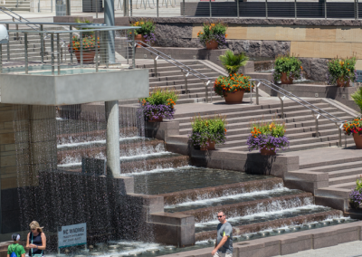 The steps are flanked by water cascades, and a plaza containing a fountain, a reflecting pool and water curtains.