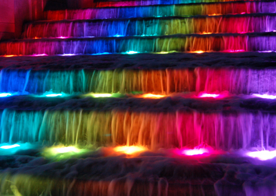The cascade fountain is a sight to see at night with LED color changing underwater lights.