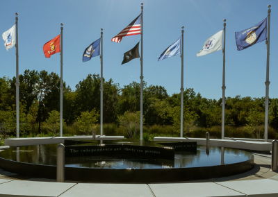 Flags of each of the service branches are displayed along with the POW/MIA flag, Merchant Marine flag and the flag of the United States.