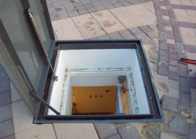 Underground fiberglass vault located in close proximity to the fountain integrated within the pavers